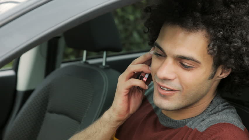 Cool Young Man Talking At Phone And Starting Car Happy Stock Footage Video  9940706 | Shutterstock