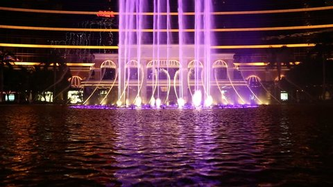 MACAO - CIRCA JUNE, 2014: Wynn Macau casino fountains is a choreographed water feature with performances set to light and music. Wynn Macao one of the best gaming and hotel complexes in Macau.