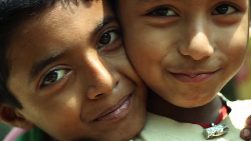 Two Indian village boys smiling and posing for the camera closeup | Shutterstock HD Video #9966776