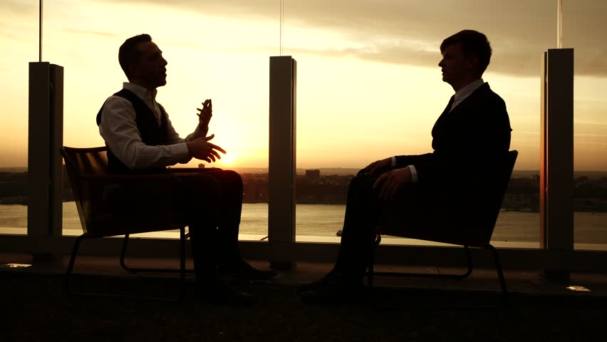 Businessman Conversation Outside At Sunset Sky. Silhouette ...