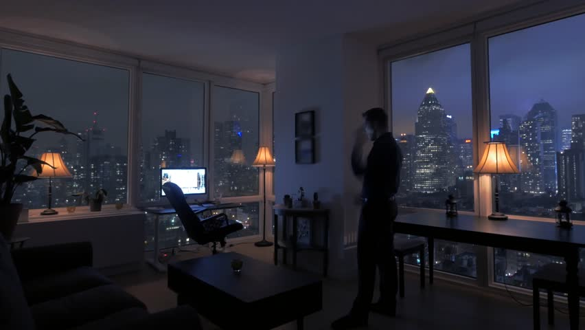 High Rise Apartment Inside one person inside apartment loft home. urban night lights